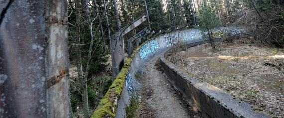 TO GO WITH STORY BY RUSMIR SMAJILHODZIC - A picture taken on February 5, 2014 shows Sarajevo's abandoned Sarajevo's bob sleigh track near Sarajevo. Built and used as an Olympic venue during Sarajevo's 1984 Winter Olympic Games, the track was heavily damaged during Bosnia's 1992-95 war. It was never rebuilt and it's large concrete fragments remain standing as a memento of past and training ground for young generations of graffiti artists. AFP PHOTO ELVIS BARUKCIC (Photo credit should read ELVIS BARUKCIC/AFP/Getty Images)